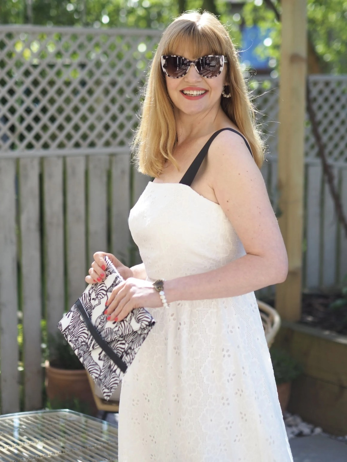 white dress with black and white sunglasses