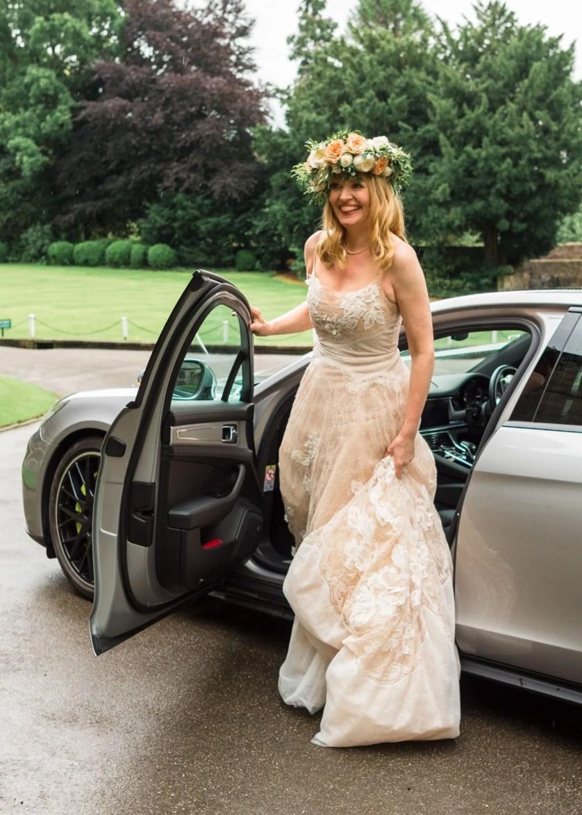 bride wearing Peregrine wedding gown by watters