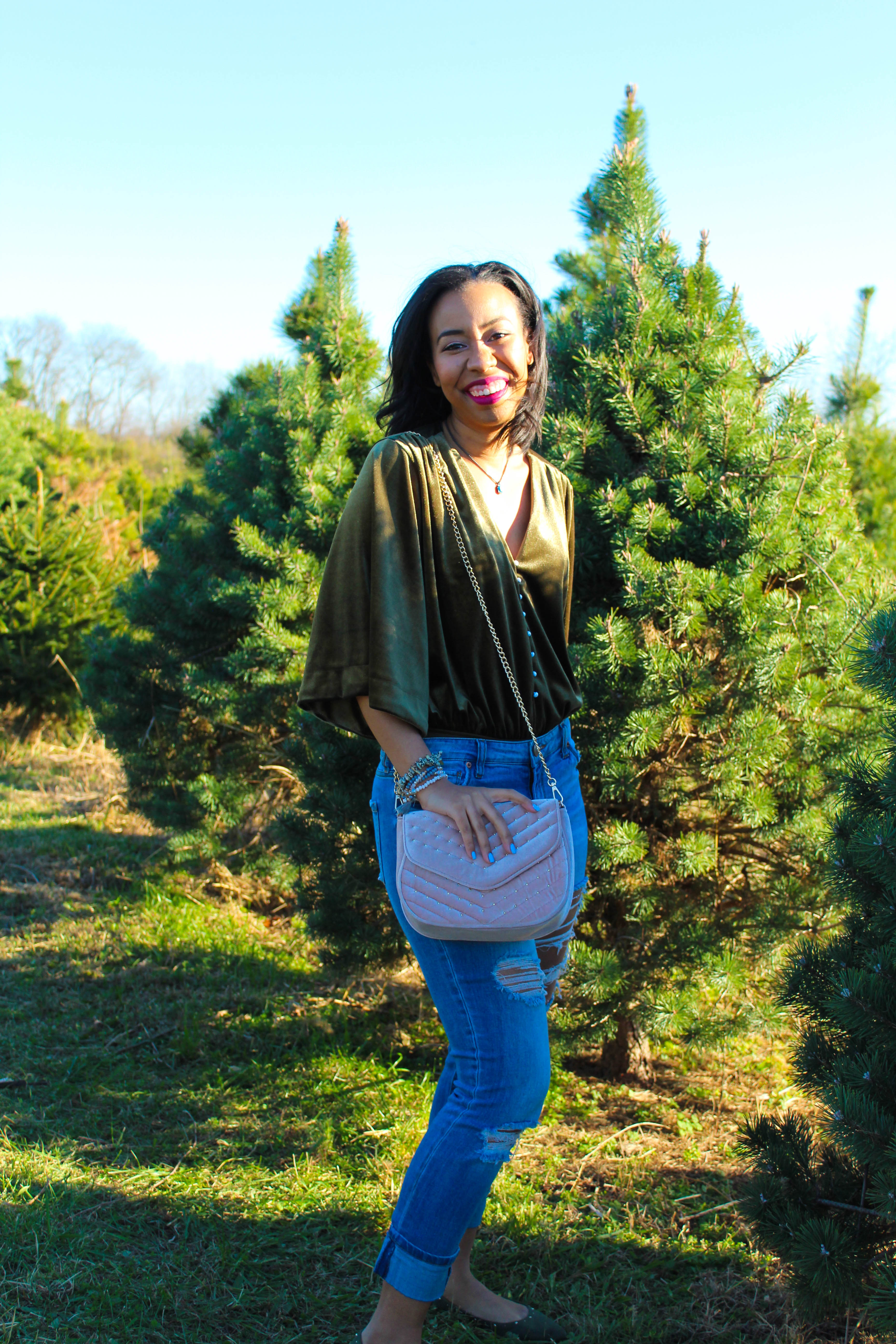 A casual velvet outfit for the fall to winter transition plus tips for dealing with the holiday blues and practicing self-care on a budget. // what to wear to a christmas tree farm, distressed jeans outfit inspiration, velvet crossbody purse, how to wear a velvet top for the holidays