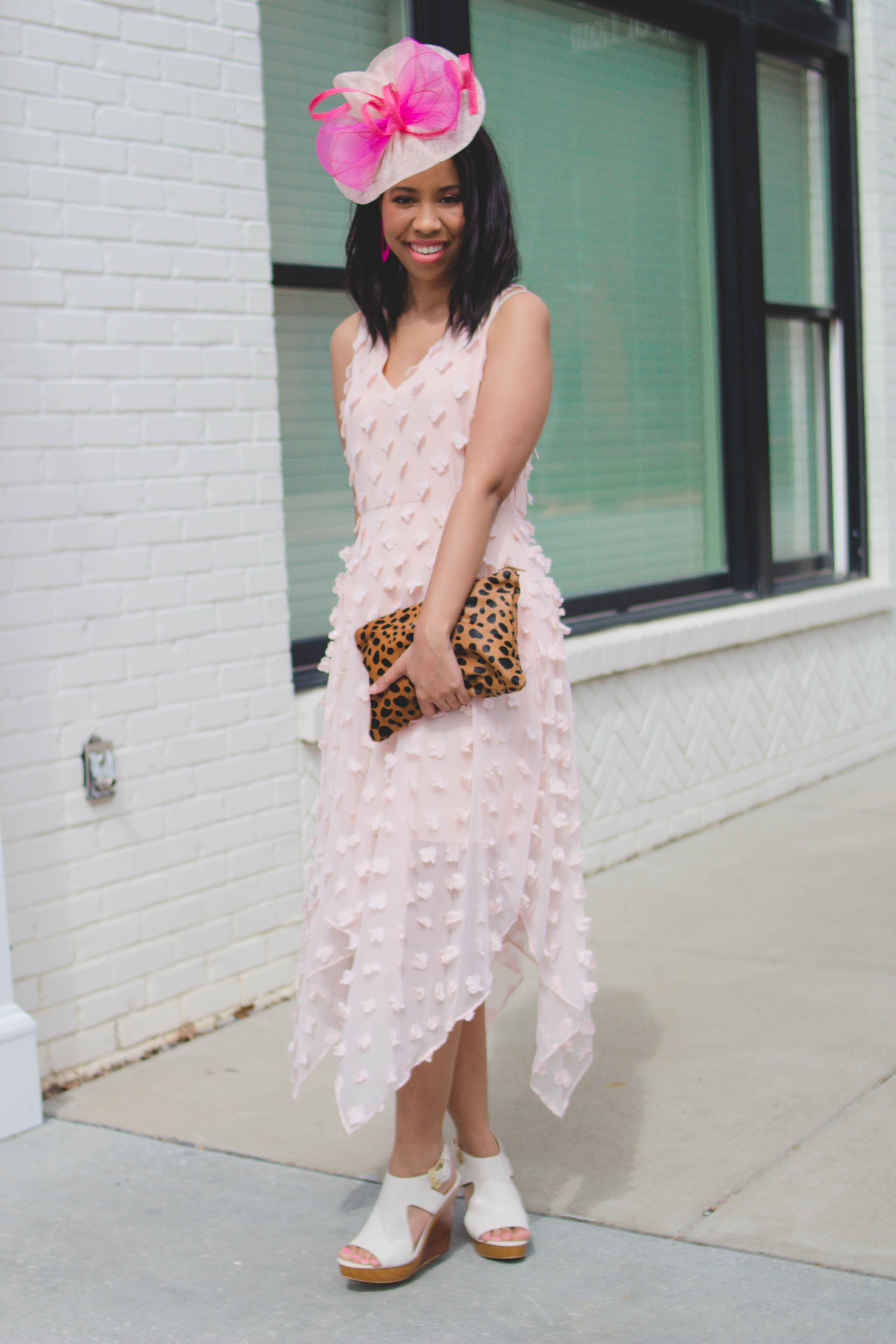 Unsure of what to wear to the Kentucky Oaks races? Louisville blogger, What Nicole Wore, shares a blush handkerchief dress for the occasion! // pink fascinator outfit, kentucky oaks outfit for women, leopard clutch outfit classy, michael kors shoes outfit