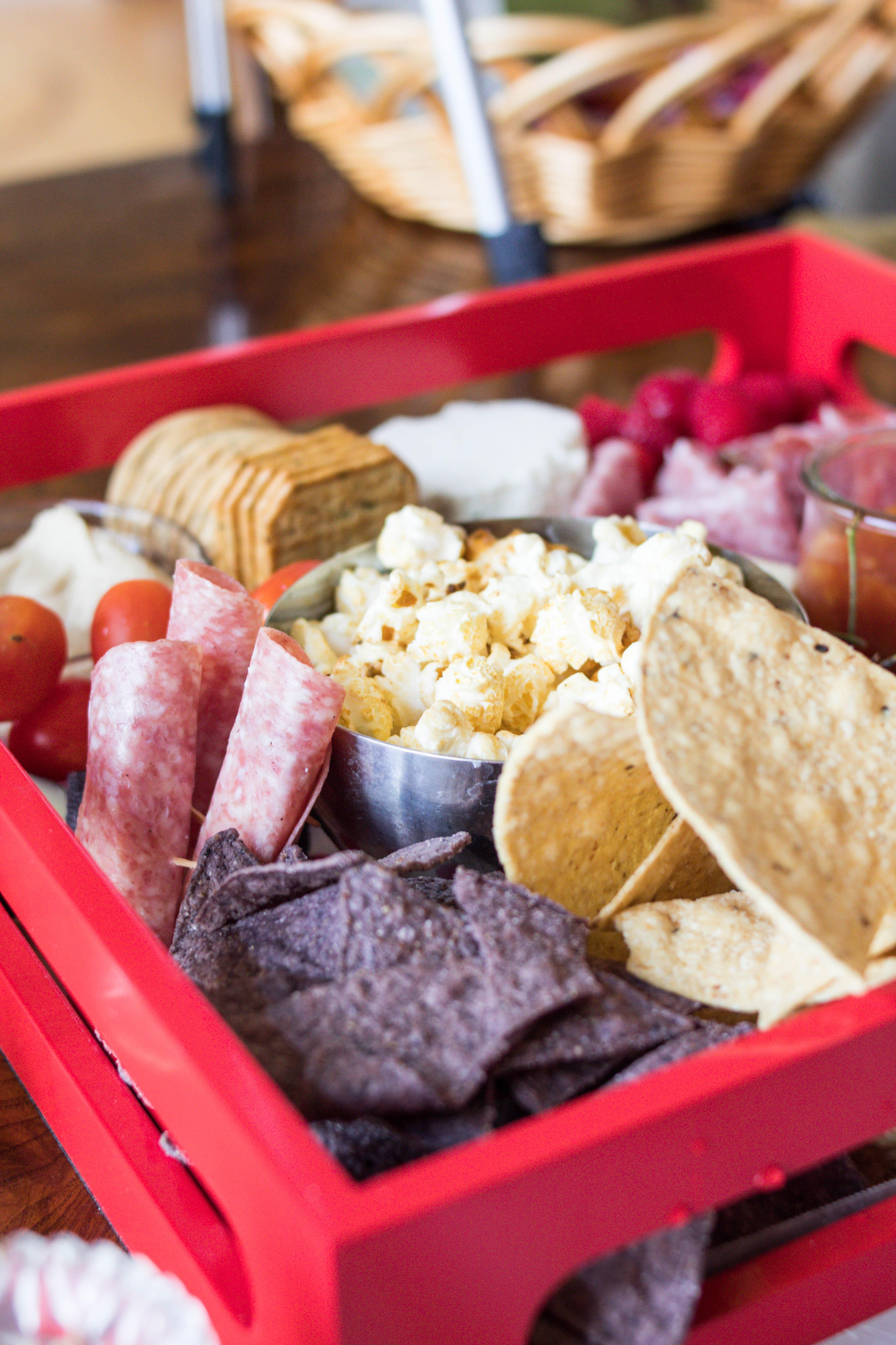 Grazing boards are all the rage right now! Lifestyle blogger, What Nicole Wore, takes you through how to assemble the best charcuterie board. // cheese board, party snacks DIY, appetizer ideas, 4th of july charcuterie board, trader joes snacks