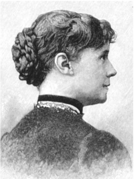 A woman with a pleasant expression and elaborately braided bun and high-collared 19th century dress is shown in profile.