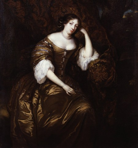 A woman in a boat-neck 17th century gown in gold silk sits on a gold damask drape, head leaning on her hand and staring at the viewer with a pleasant expression. She has dark hair and extremely pale skin.