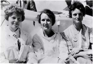 Amelia Earhart, Ruth Nichols, and Louise Thaden in front of a plane