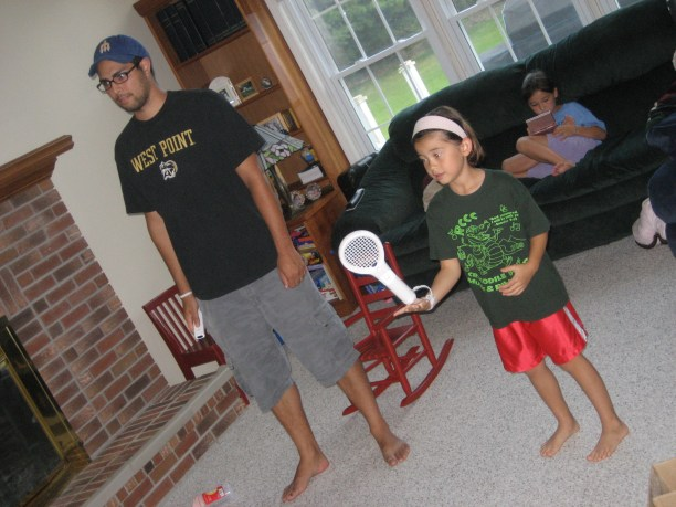 RJ and Kayla playing Wii tennis