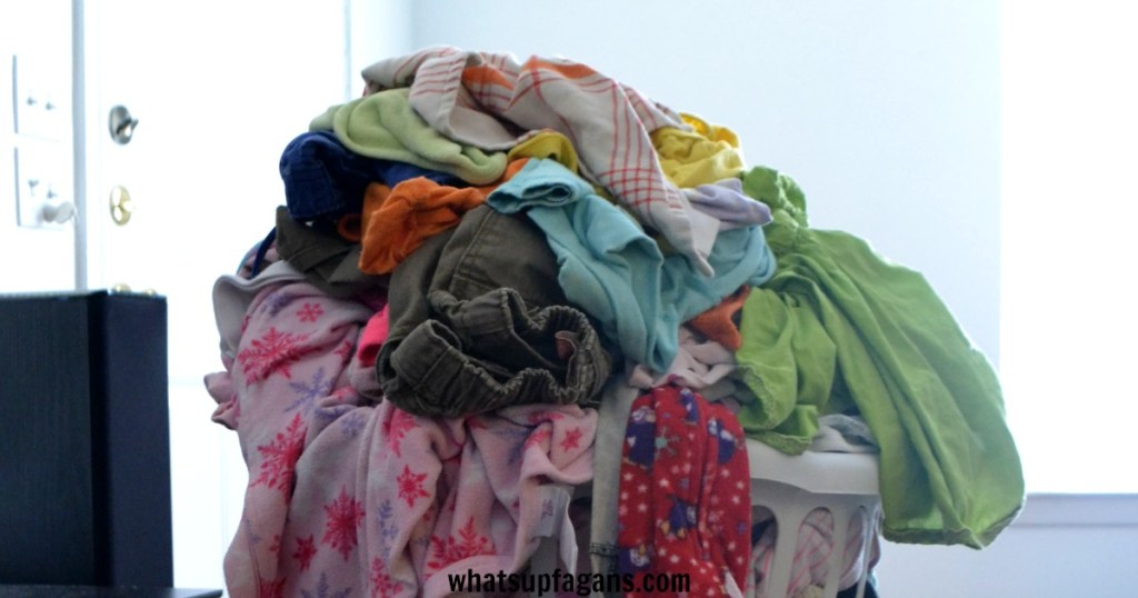 A pile of laundry in a laundry basket