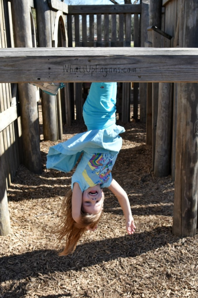 Hanging upside down at the playground