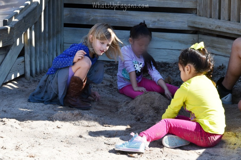 playing in the sand at the park