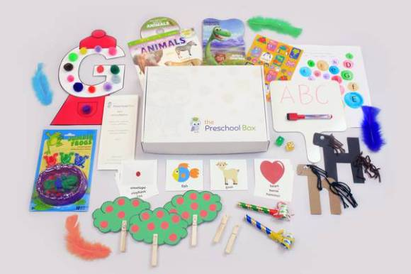 The Preschool Box unboxed on table - letters and crafts and learning materials