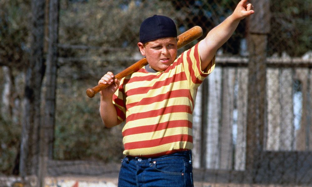 Patrick Renna as Ham Porter in scene from the 1993 film The Sandlot - playing a pickup game of baseball as a backyard game for the neighborhood.