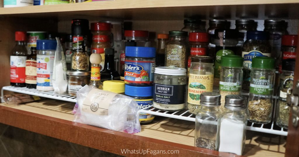 how toorganize spices in a kitchen cabinet