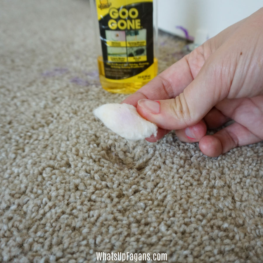 purple acryclic paint residue on a cotton ball soaked in Goo Gone - one method for how to remove acrylic paint from carpet