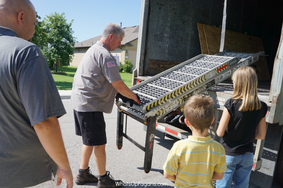ABF UPack moving company employee showing Upack reviews family how to use the trailer ramp which is included with the trailer rental
