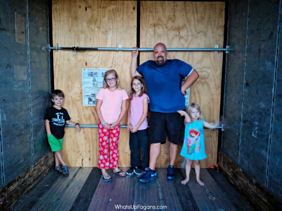 family inside Upack moving trailer as they do Upack reviews of their moving services