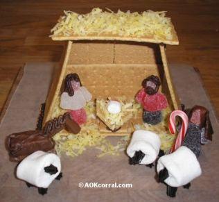 edible nativity scene craft using marshmallows, graham cracker manger, and gum drop people.