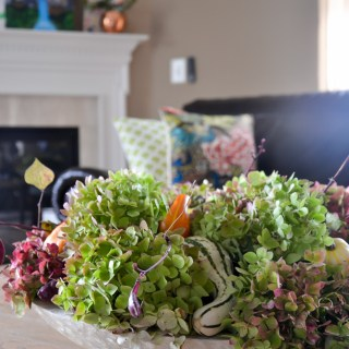 Fall centerpiece with pumpkins gourds and hydrangeas