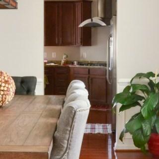 DiningRoomdecorideas Transitionalstyle,greyupholsteredchairs,woodtable,largechandelier BenjaminMooreReverePewter