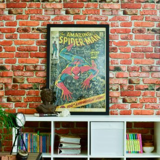 Accent brick wall with in family room- spiderman poster, loft style family room