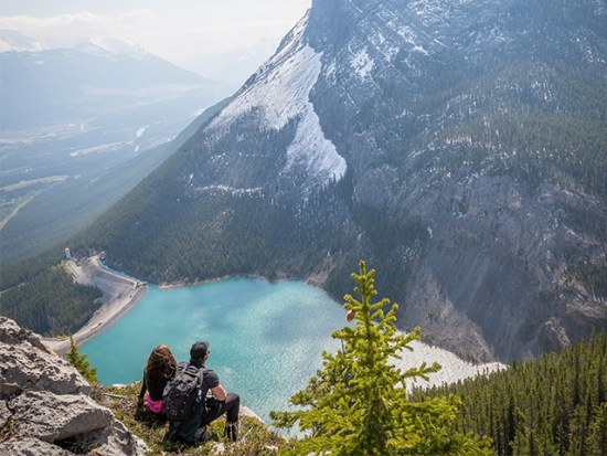 Man and Woman Overlooking Lake on Hike