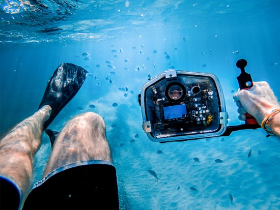 Man Snorkeling with Camera in Underwater housing.