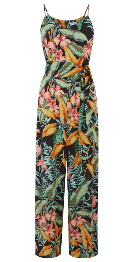 Warehouse cami jumpsuit with belt in tropical print.