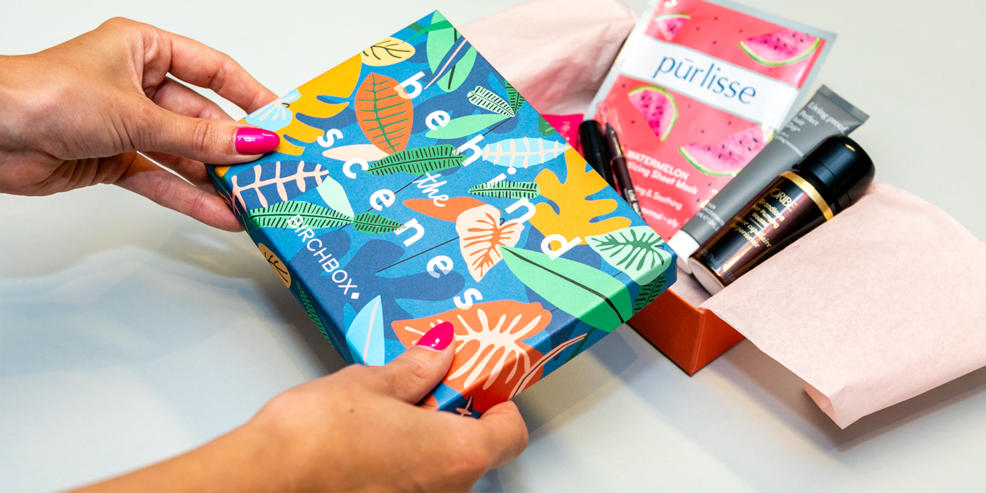 Opening a birchbox subscription box.