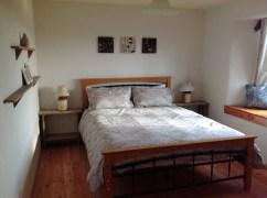 The master bedroom at Balebarn Eco Lodge