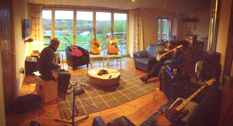Musicians playing inside Balebarn Eco Lodge at Wheatland Farm, Devon
