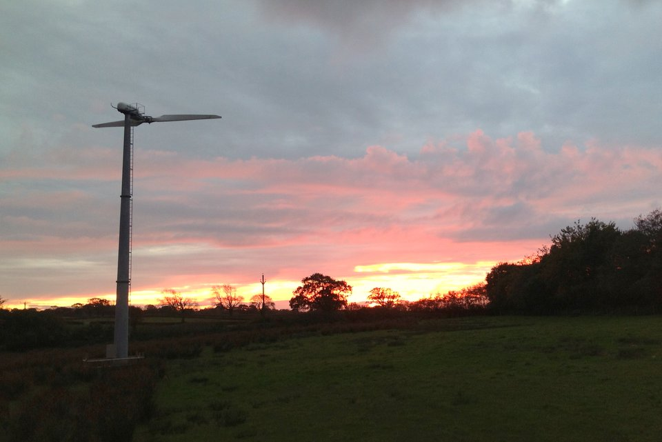 Wheatland Farm's turbine at sunset