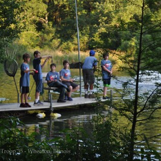a dockful of scouts fishing and having fun