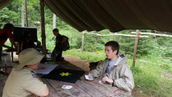 Michael W. playing cards at Handicraft with a scout from another troop.