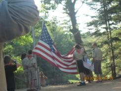 Troop 35 lowers the camp flag