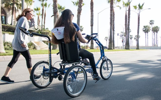 woman next to girl on Freedom Concepts adaptive bike