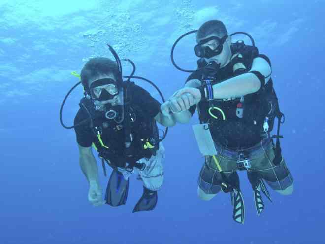 Two divers under water