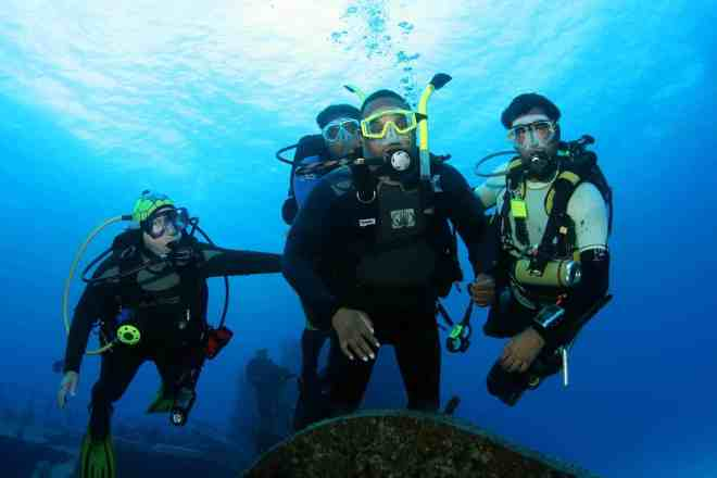 group of divers underwater