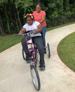 a young girl on her Freedom Concepts bike