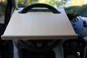 Notebook Wheeldesk car desk mounted on a car steering wheel - front view.