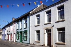 Residential Conveyancing at Wheelers Solicitors | Online quotes for conveyancing | Row of residential houses and bunting | Wheelers Solicitors Newport Isle of Wight