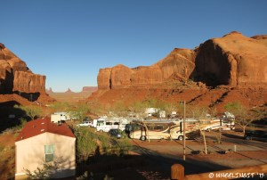 View down the row from top. Our RV on right. Slot view of Monument Valley in background.