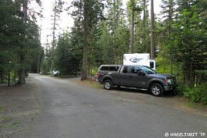View down back-side of campground. RV in site #B25 with B23, BB21 behind it. These are all full hookup