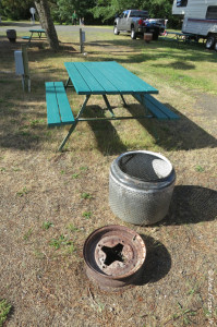 Picnic table and fire-pit at each site. You can see site behind this and another to the back right.