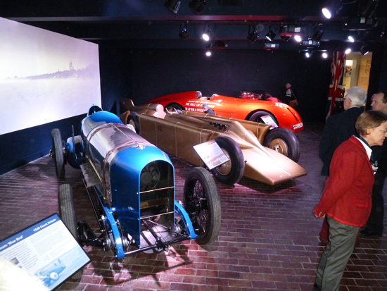 Three of the four Land Speed Record breaking cars in the new display at the National Motor Museum, Beaulieu. Sandwiched between the 350 hp and 1,000 hp Sunbeams is the strikingly-styled Golden Arrow.