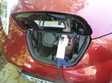 This shot shows the LEAF being recharged via a domestic electricity supply (the additional socket alongside is for recharging via public charge points).