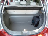 The luggage compartment is spacious, even though there is some intrusion by a large 'beam' running across the car, behind the rear seats. The bag on the right of the boot in this shot houses the charging cable.