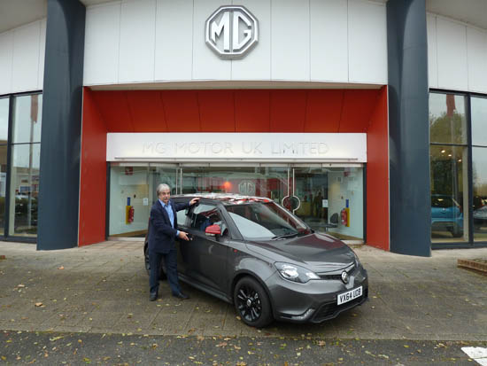 Kim Henson visited MG's home at Longbridge, Birmingham for 'Wheels-Alive', and test-drove a prototype of the firm's new 'Electric Vehicle Concept' car. He is seen here with a new MG3