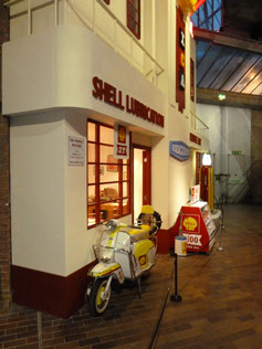 I always love seeing this recreation of an 'art deco' Shell garage frontage, complete with period advertising and the Lambretta motor scooter, finished in 'Shell' colours.