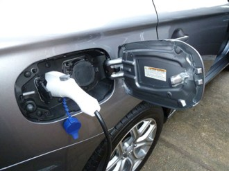 The twin electrical sockets for charging the Outlander PHEV are located beneath a hinged flap on the right-hand side of the car; the fuel filler is positioned on the opposite side of the vehicle.
