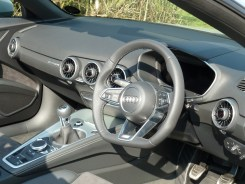 Modern dash design within a comfortable two seater cockpit. This car has a six speed manual gearbox. Note the 'drive select' rotatable control behind the gear lever.