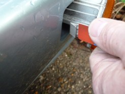 ...is gently pushed against the retaining clip like this, to allow the lamp unit to be eased from the bumper.