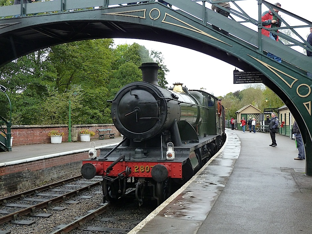 Heavy Freight locomotive 2807 arrives in the rain at Pickering station on the North Yorkshire Moors Railway. This ex Great Western loco dates from 1914 and is the oldest surviving standard class engine (the standard class steam locos were introduced by George Jackson Gloucster).